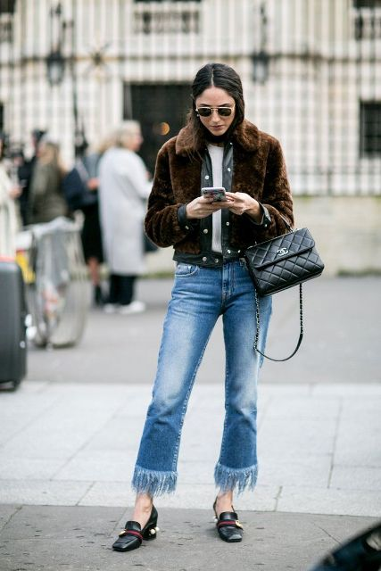 With white t shirt, brown faux fur jacket, black leather bag and embellished shoes