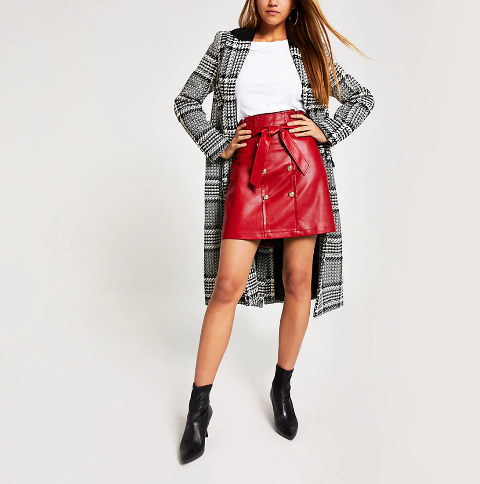With white t-shirt, checked midi coat and black heeled boots