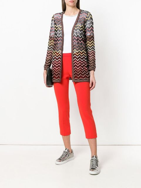 With white t-shirt, red cropped pants, black clutch and silver lace up shoes