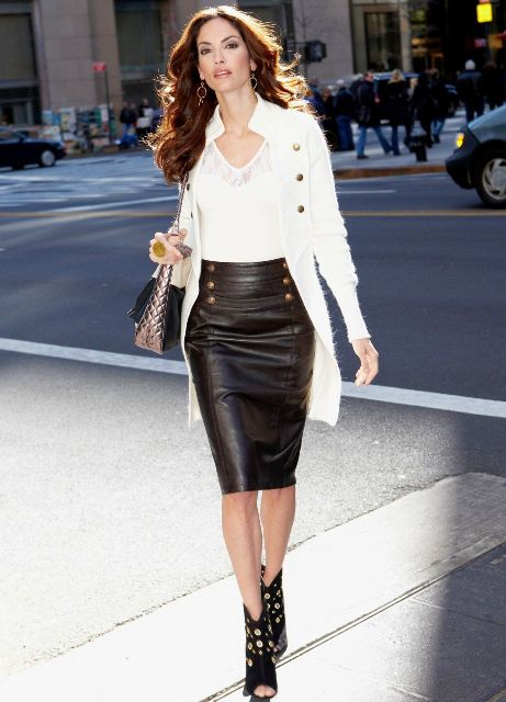 With white top, white cardigan, metallic bag and cutout boots