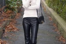 With white turtleneck, black mini bag and black boots