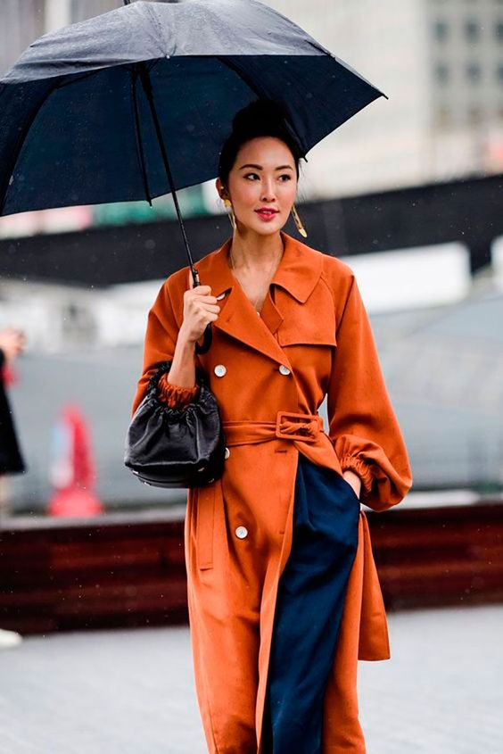 a beautiful rust-colored trench with white buttons is a cool bold touch to your fall look