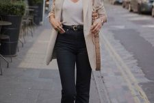 a beige blazer, a white cami top, black crop jeans, snake print mules, black sunglasses and a beige shoulder bag