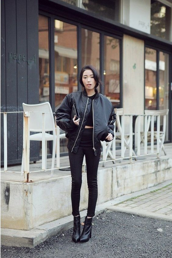 a black cropped tee, skinny pants, a leather bomber jacket, booties and a clutch for the fall