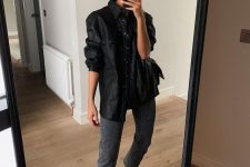 a black leather shirt, graphite grey cropped jeans, black strappy shoes with square toes