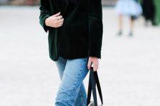 a black shirt, a dark green velvet blazer, blue jeans, a plaid bag and bright green booties