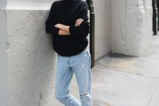 a black sweater, blue ripped jeans, black lacquer boots for a casual fall look