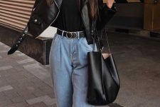 a black tee, light blue slouchy jeans, black booties and a black leather jacket plus a black tote