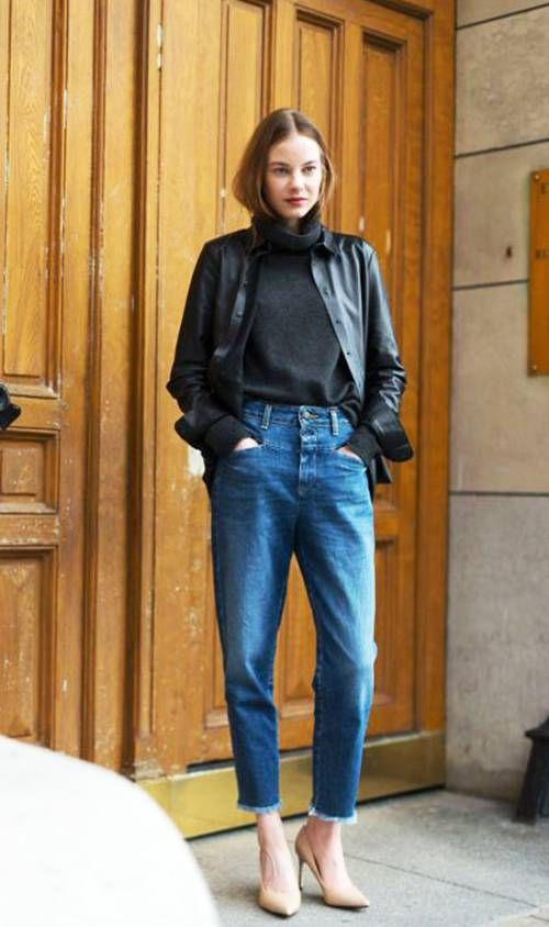 a black turtleneck, a black leather shirt, blue jeans and tan shoes for a comfy casual look