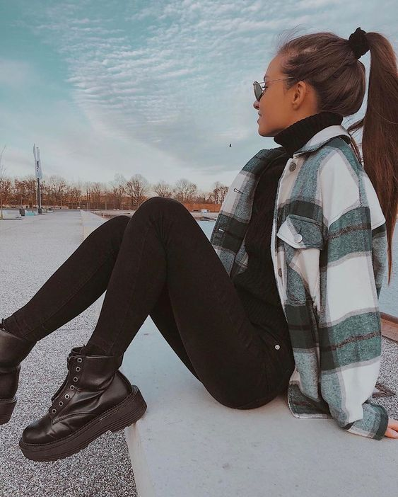 a black turtleneck, black skinnies, combat boots, a plaid shirt jacket for a sexy and chic look