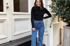 a black turtleneck, blue straight leg jeans, snakeskin booties for a simple and basic fall look