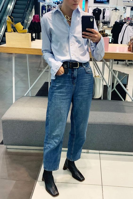 a blue shirt, blue straight jeans, black square toe ankle booties plus a chunky chain necklace