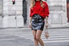 a bright outfit with a red oversized sweater, a black lacquer leather mini and fuchsia sock boots