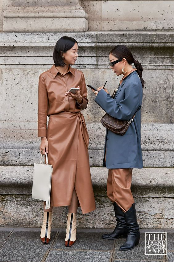 a brown leather shirt, a matching midi wrap skirt, color block boots and a white bag