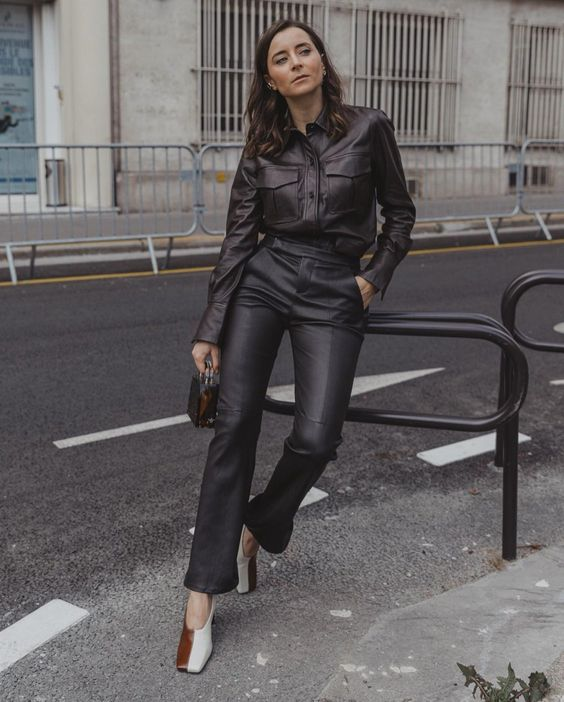 a brown leather shirt, black leather pants, color block shoes and a mini bag for the fall