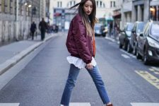 a burgundy bomber jacket, a white shirt, blue jeans, burgundy suede booties for the fall