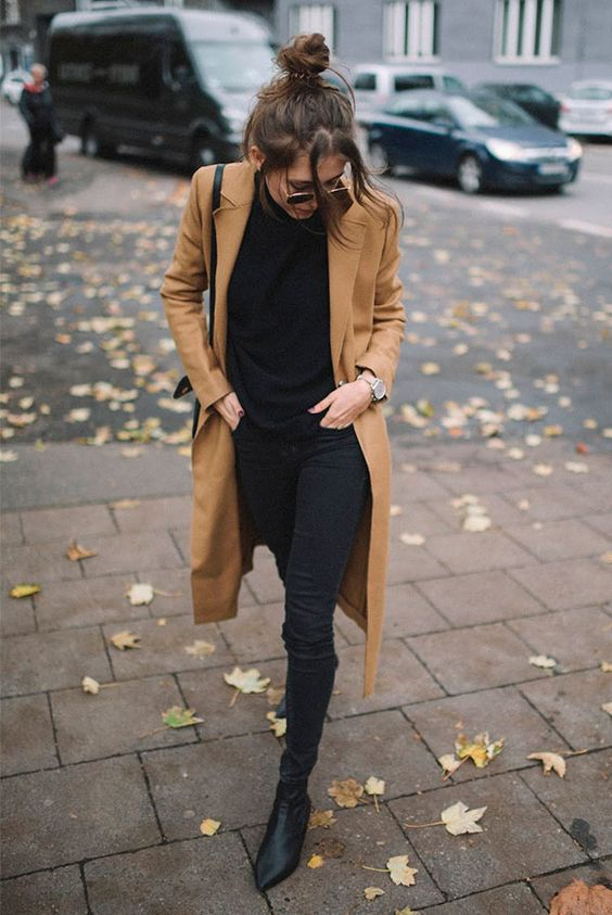 a chic casual look with a black turtleneck, skinnies, sock boots and a camel coat is classics
