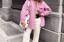 a chic look with a tan top, white jeans, a pink shirt jacket, snakeskin print boots and a printed tote