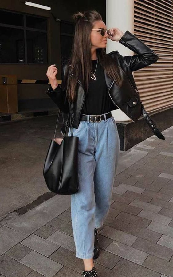 a comfy and chic fall look with a black tee, a black leather jacket, blue slouchy jeans, a tote