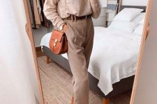 a comfy outfit with a tan top, tan pants, a brown belt, leopard shoes and a rust-colored bag