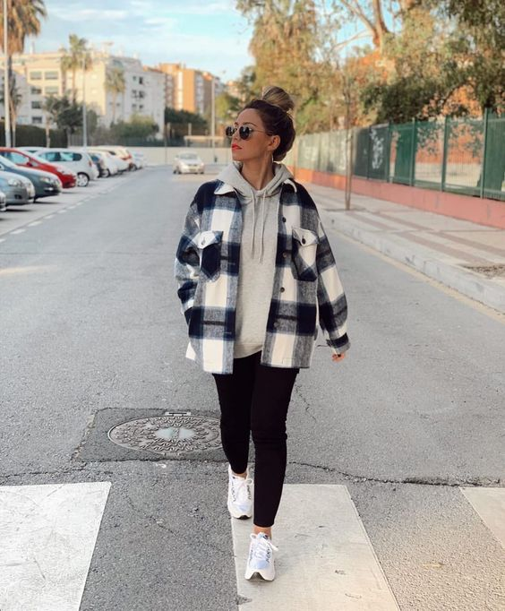a comfy sporty look with a grey hoodie, a plaid shirt jacket, black skinnies and white trainers
