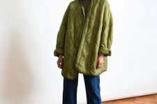 a dark top, blue straight wideleg jeans, green metallic shoes and an oversized green quilted jacket