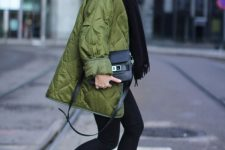 a fall look with a black scarf, skinnies, heeled booties and a green quilted jacket for a touch of color