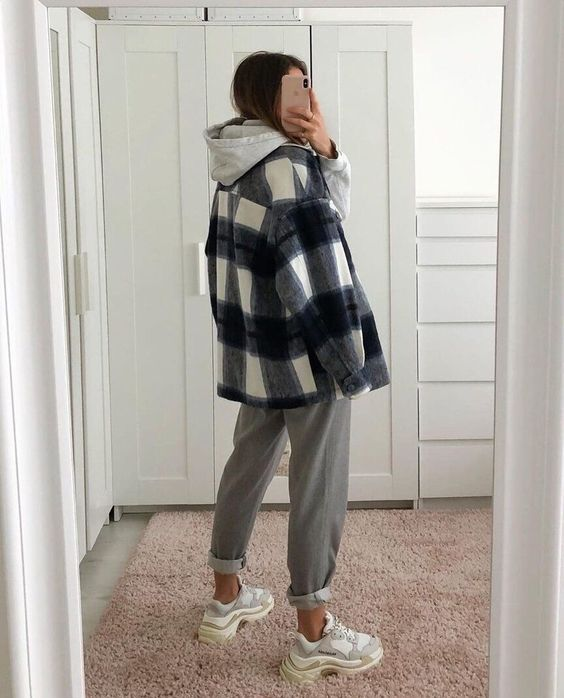 a grey hoodie, a plaid shirt jacket, grey pants, white and grey trainers for a super comfortable look