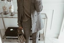 a grey plaid pantsuit, a grey oversized turtleneck, taupe boots and a grey bag for the fall