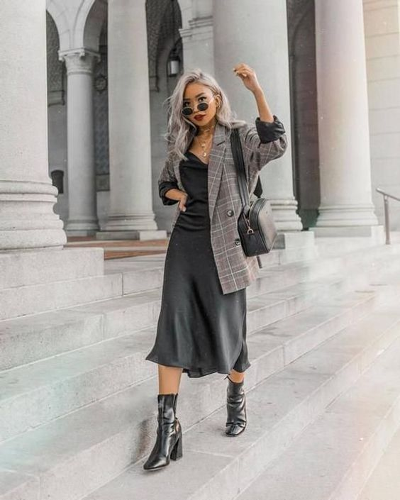 a grey slip dress, an oversized grey plaid blazer, a black bag and black square toe boots
