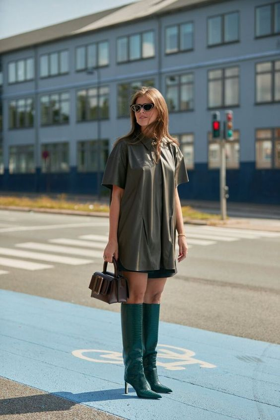 a leather shirt, black shorts, bold green boots and a brown bag for a statement look