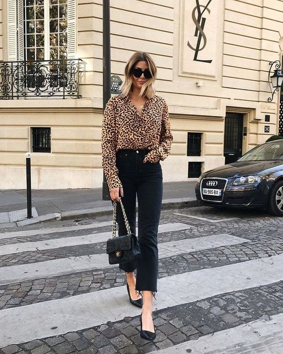 a leopard print shirt, black straight leg jeans, black shoes and a black crossbody for a bold look