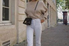 a neutral sweater, white straight leg jeans, tan suede booties and a black crossbody bag