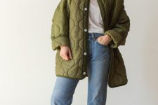 a neutral tee, blue straight jeans, white booties, a green oversized quilted jacket