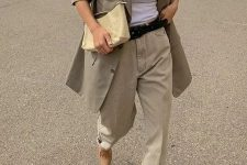 a neutral work look with a white top, an olive green oversized blazer, neutral slouchy jeans, tan heels and a yellow bag