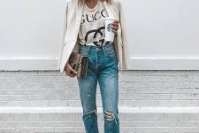 a printed light tee, blue ripped jeans, a white blazer, snakeskin print booties and a taupe bag