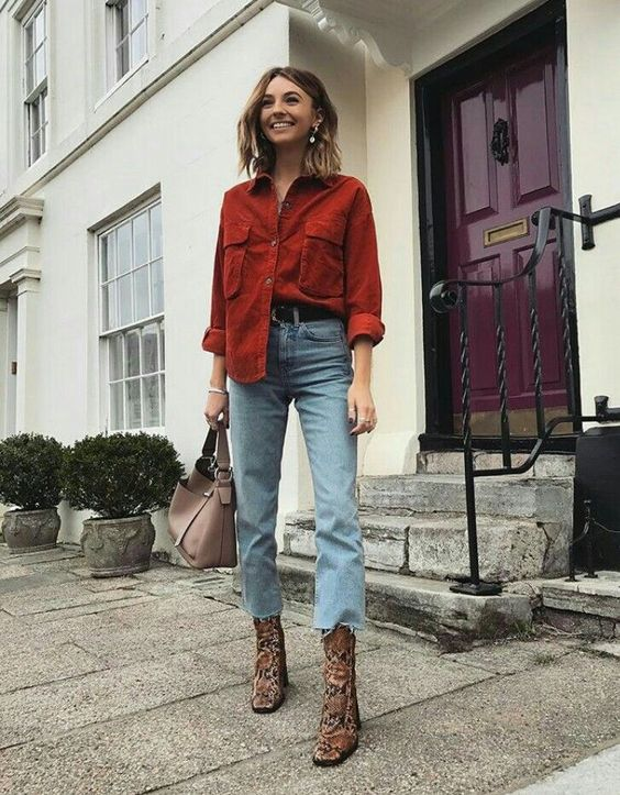 a red chambray shirt, blue raw hem jeans, snakeskin print ankle booties and a dusty pink bag