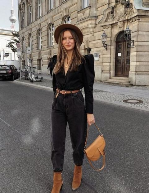 a refined fall outfit with a black puff sleeve blouse, black slouchy jeans, a hat, a camel baguette bag and brown boots