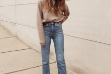 a simple and comfy fall look with a tan sweater, blue straight leg jeans and brown shoes square toe boots