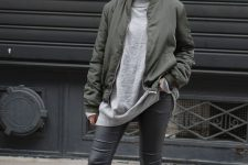 a simple look with an oversized grey turtleneck, grey leather pants, white sneakers and an olive green bomber jacket