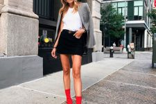 a cool skirt and boots combo look for fall