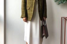 a stylish summer to fall outfit with a white printed shirt, an asymmetric white skirt, a green plaid blazer, green shoes and a burgundy bag