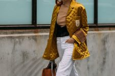 a tan turtleneck, white jeans, black boots, a gold metallic quilted jacket, a tan tote
