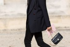 a total black look with a top, an oversized blazer, black skinnies, a small bag and hot pink glitter booties