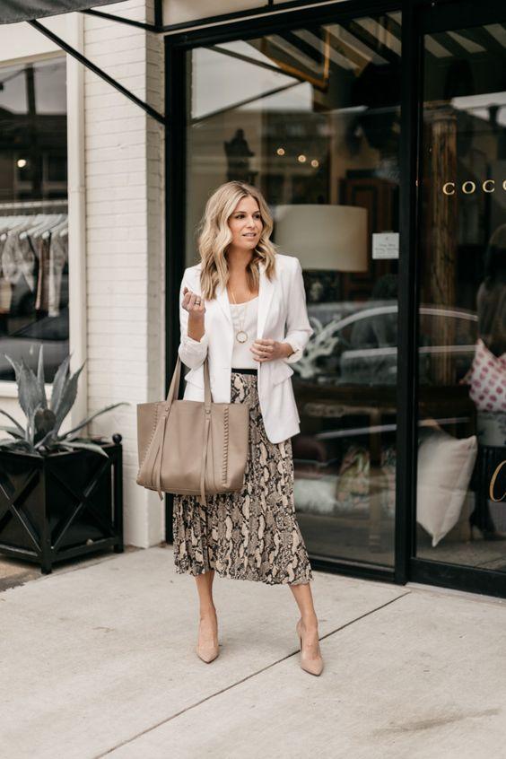 a white cami top, a snakeskin print midi skirt, a white long blazer, tan shoes and a tan bag