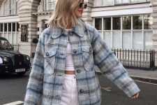 a white crop top, white high waisted jeans, blue plaid oversized shirt jacket for maximal comfort