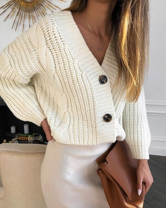 a white knit skirt, a creamy chunky knit cardigan, a brown clutch for a work look