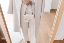 a white polka dot blouse, pants, two tone shoes, a coat and a light pink pink crossbody bag