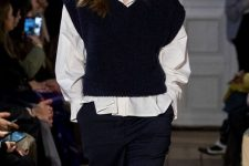 a white shirt, navy striped pants, a black knit vest for a monochromatic casual outfit
