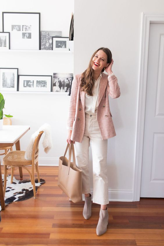 a white shirt, white straight leg jeans, dove grey booties, a pink blazer and a tan tote for work